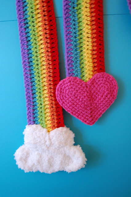 a rainbow coloured scarf with a heart on one end and a cloud on the other