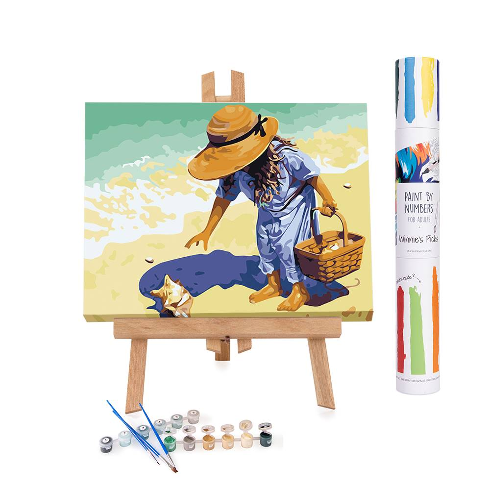paint by numbers painting of a girl picking shells on a beach.