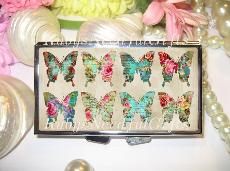 butterfly decorated pill organiser