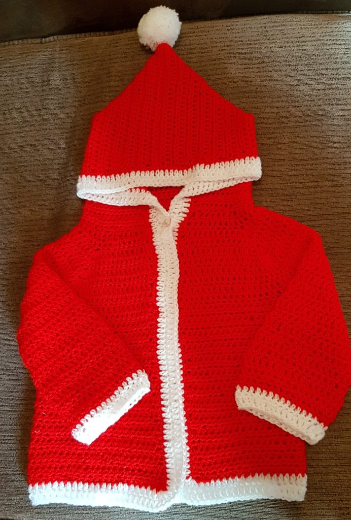 crochet red and white santa jacket for a baby.