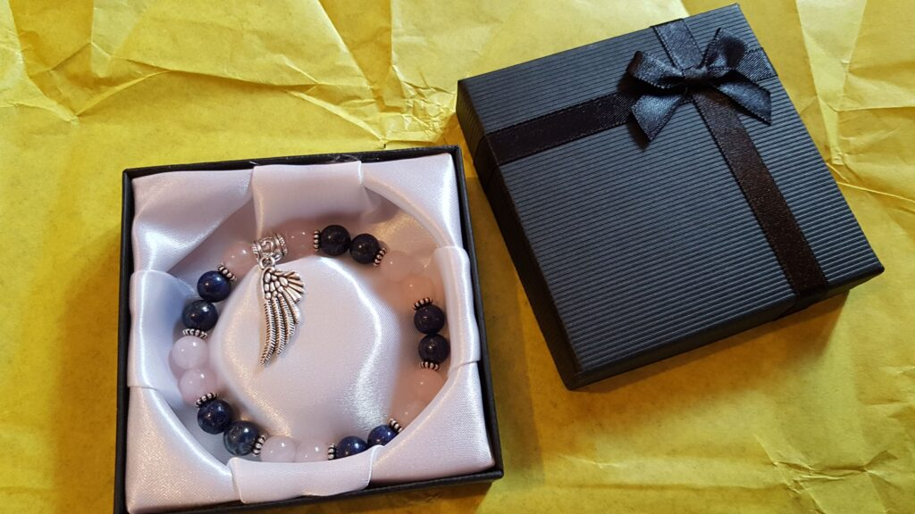 lapis lazuli and rose quartz bracelet in box.