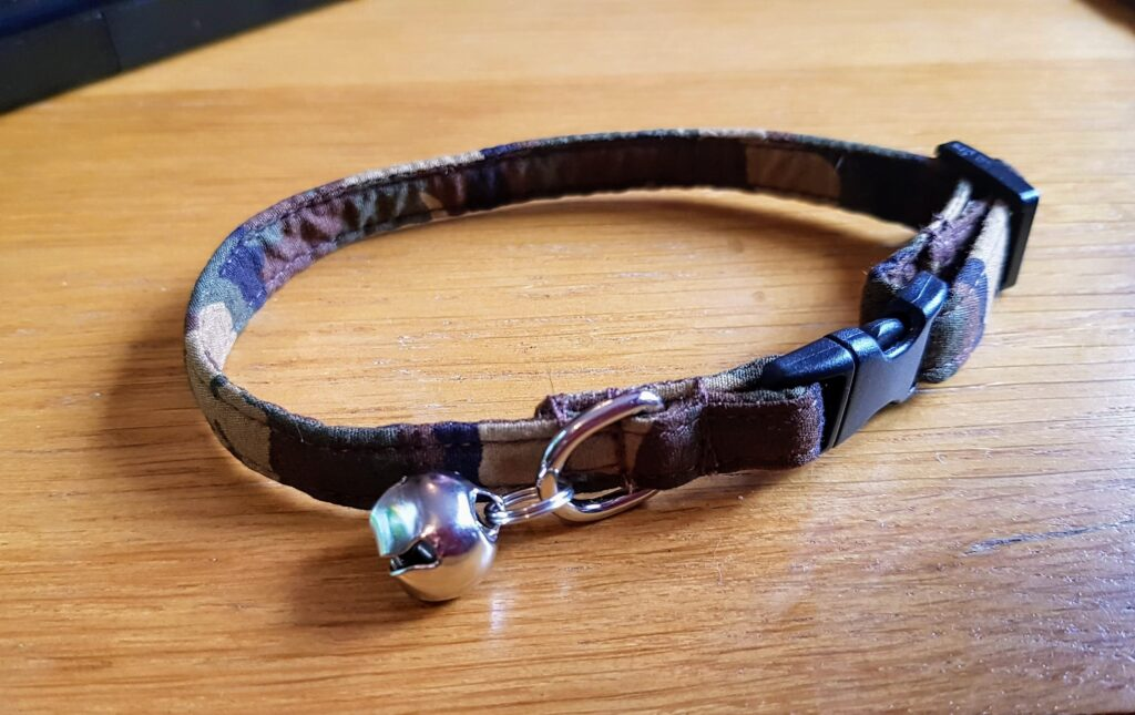 camo cat collar with a little bell.