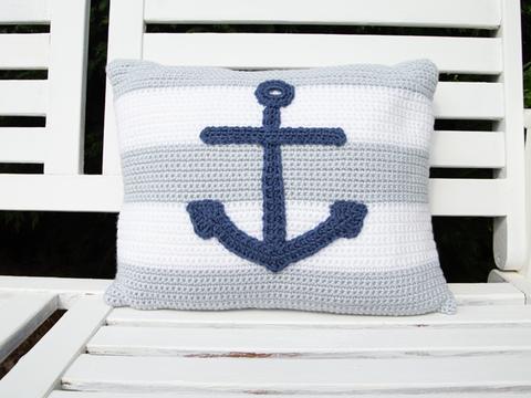 image shows a rectangluar anchor cushion on a nautical theme.