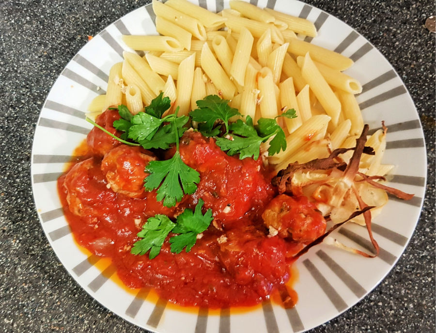 mindful eating, image shows pork meatballs in a rich tomato sauce