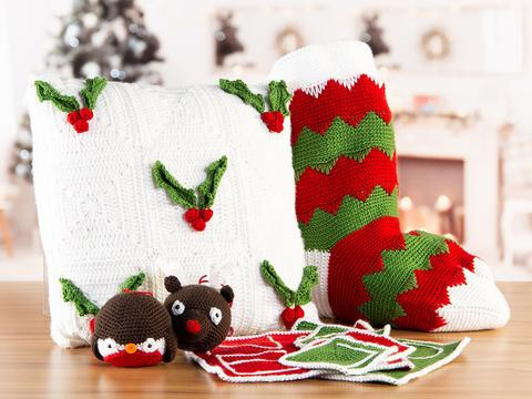 Christmas crochet along pack with cushion tree decorations, placemats and a big Christmas stocking