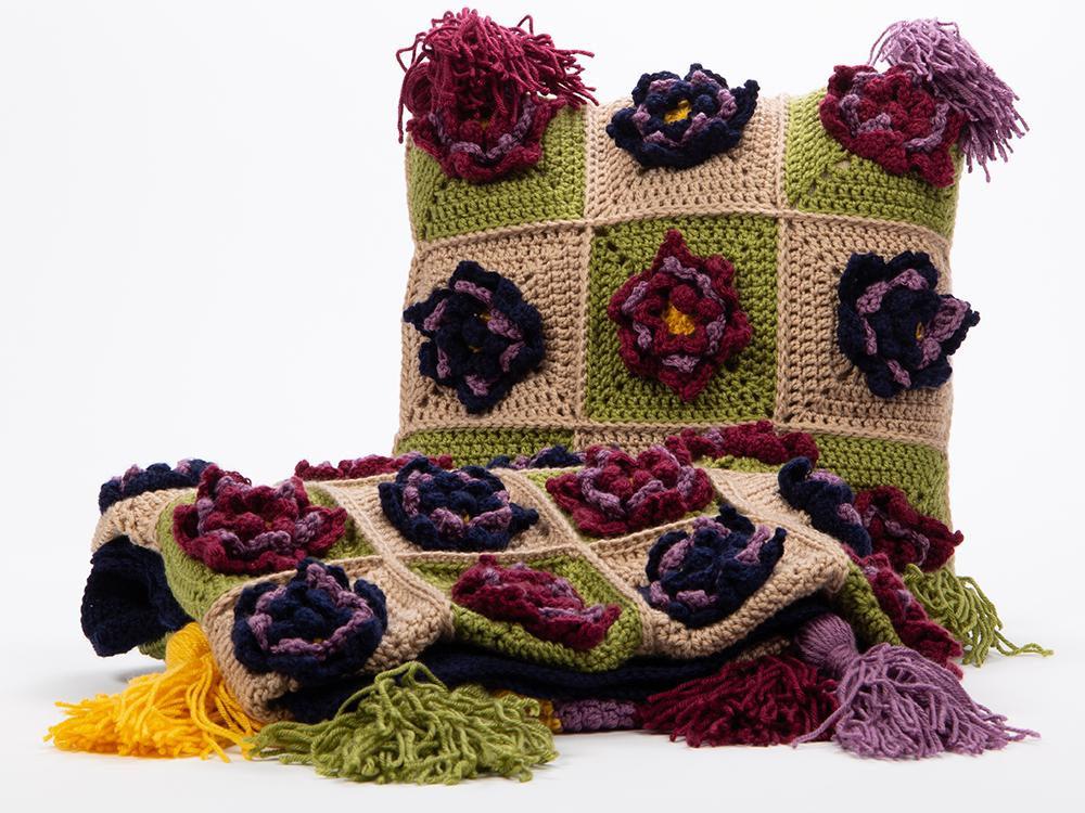cushion and throw covered with flowers
