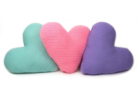 three cushion hearts in pale blue, baby pink and pale purple