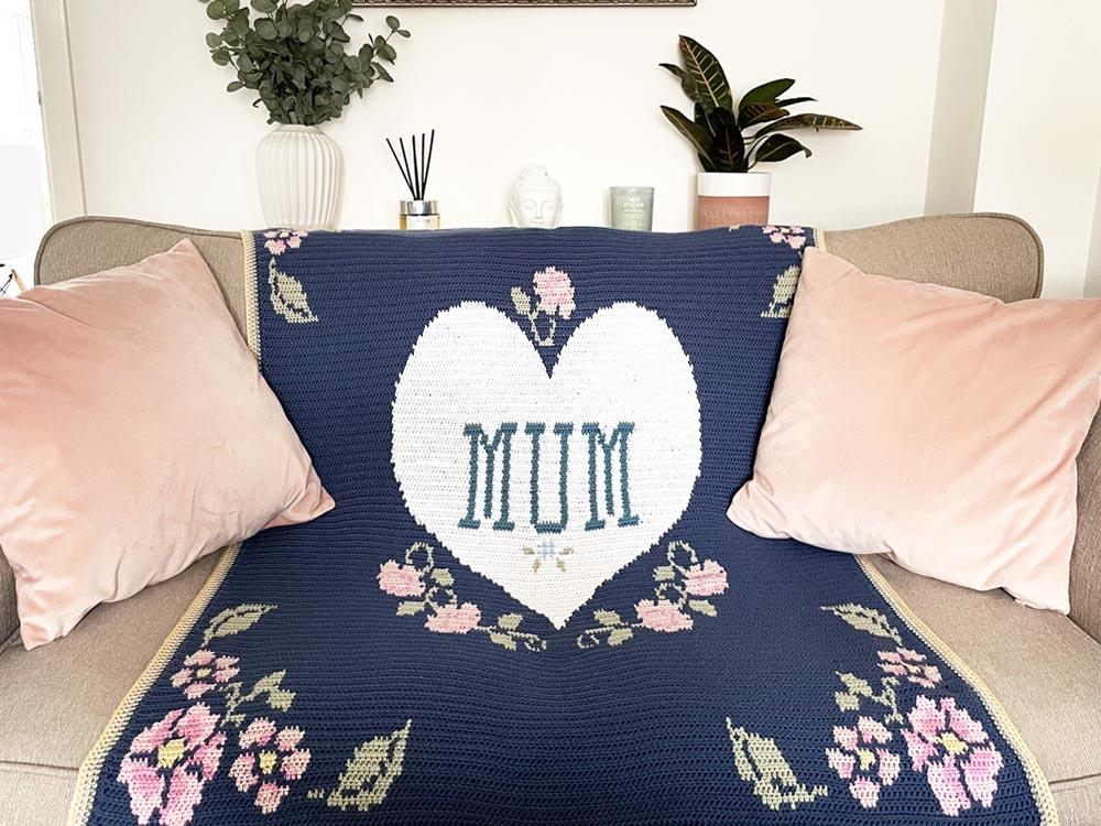 blue and pink blanket with flowers and heart and the word Mum