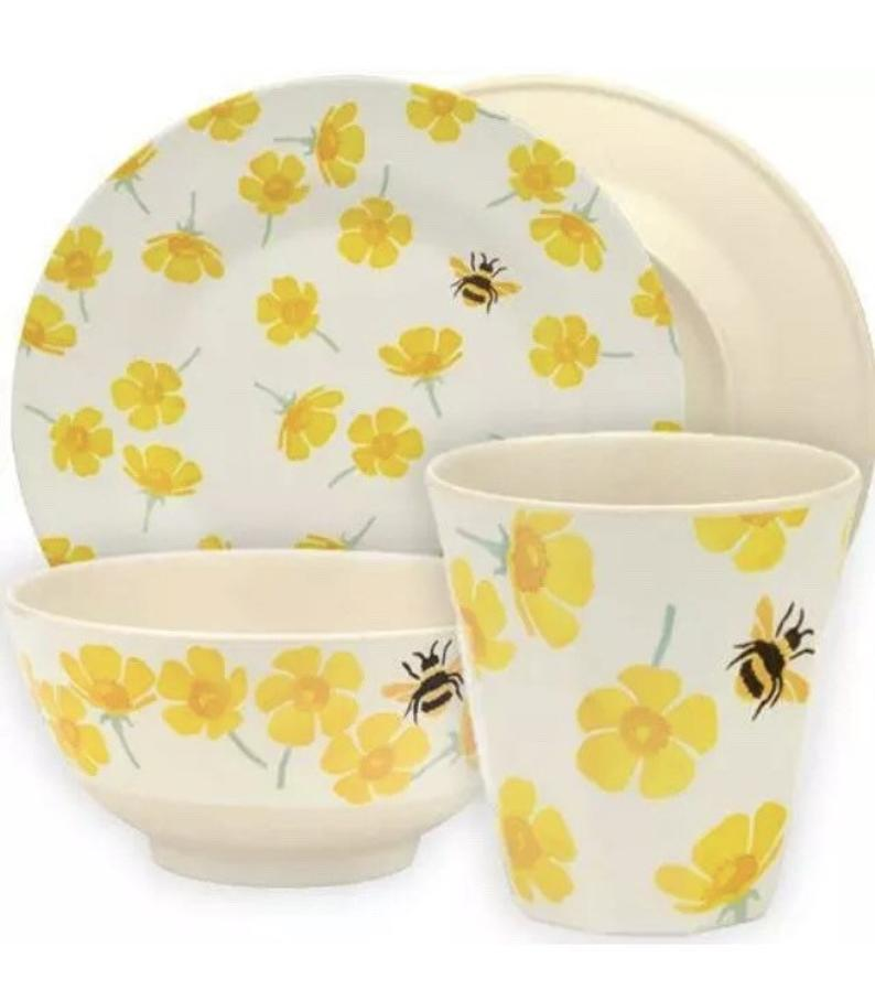 plate, bowl and beaker set with yellow flowers and bumble bees.