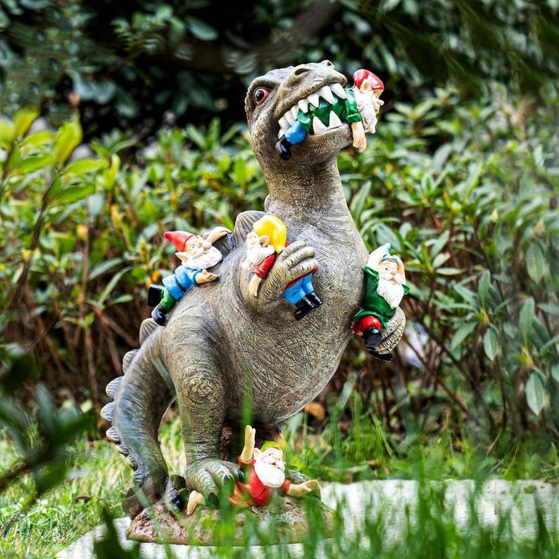 T rex dinosaur garden ornament, attacking garden gnomes.