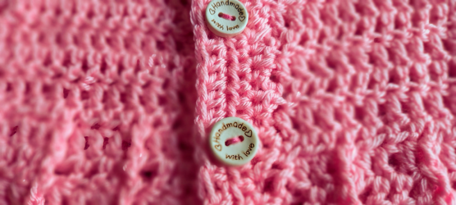 close up of baby cardigan showing cute buttons